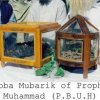 Jubba Mubarik Sharif (Cloak) of Prophet of Islam the infinite light Peace be upon Him in square display while the round one is the turban and tasbeeh of Sayedna Baba Ji Sarkar ra